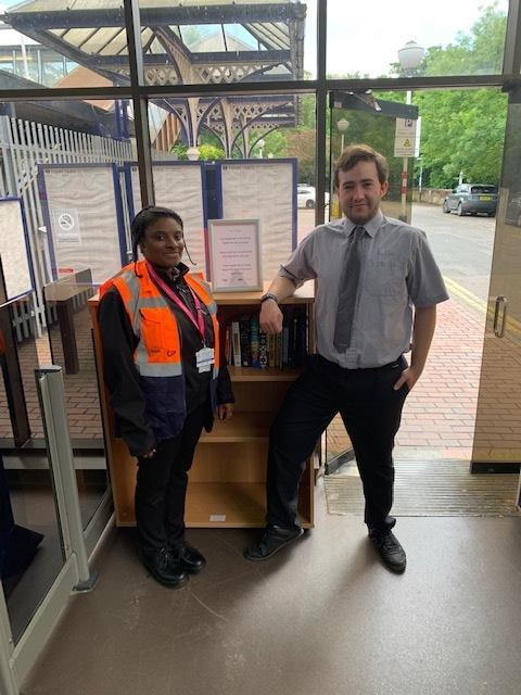 Thameslink staff Phyllicia Salmon and Stuart Miller, who are both based at Radlett, by the 'mini library' at the station