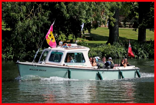 Borehamwood Times: Festival goers arriving by boat
