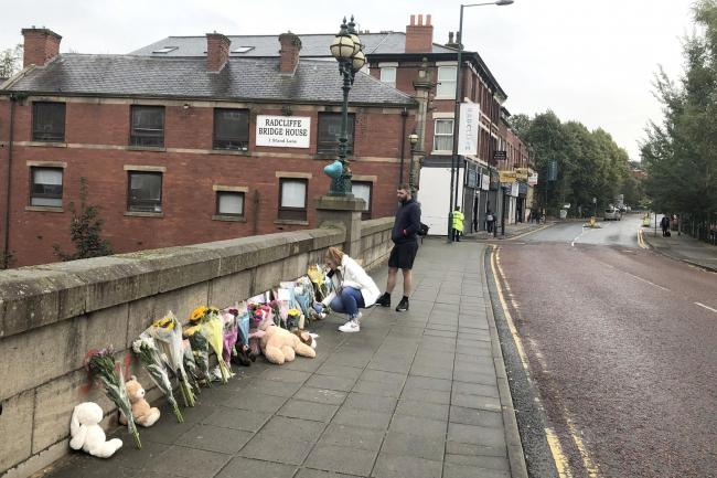 Floral tributes left on a bridge in Radcliffe