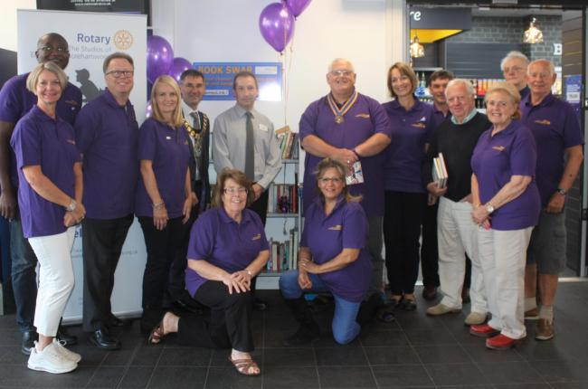 Members of the Rotary club, all in purple, town mayor Cllr Simon Rubner (centre)