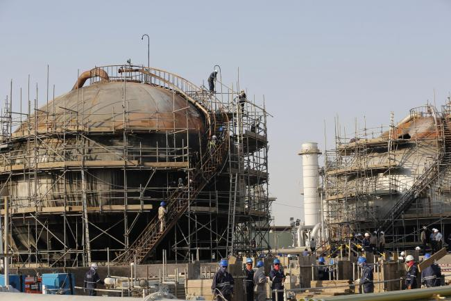 Workers fix the damage in Aramco's oil separator after the recent attack