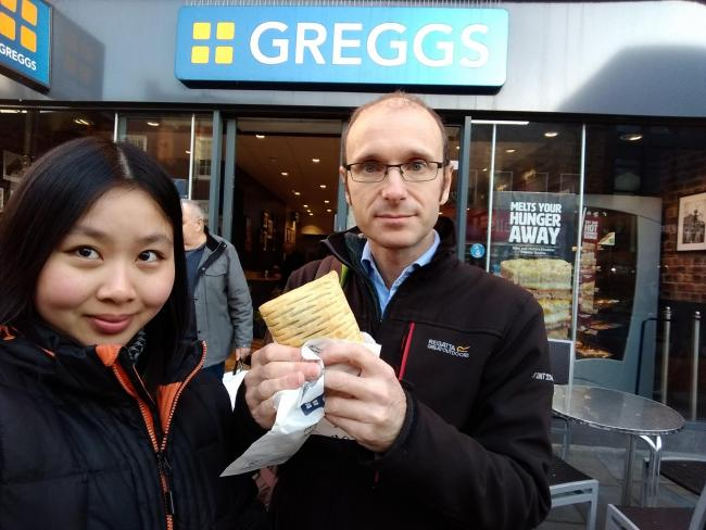 Editors Ann Yip and Robert Collins at the nearest Greggs store. Photo: Robert Collins