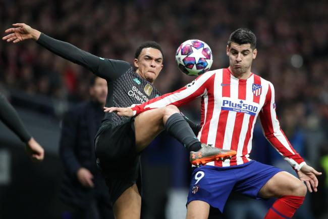 Liverpool's Trent Alexander-Arnold (left) and Atletico Madrid's Alvaro Morata battle for the ball