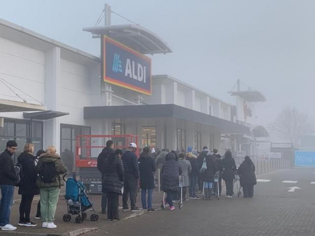 Shoppers queuing outside Aldi in Watford.