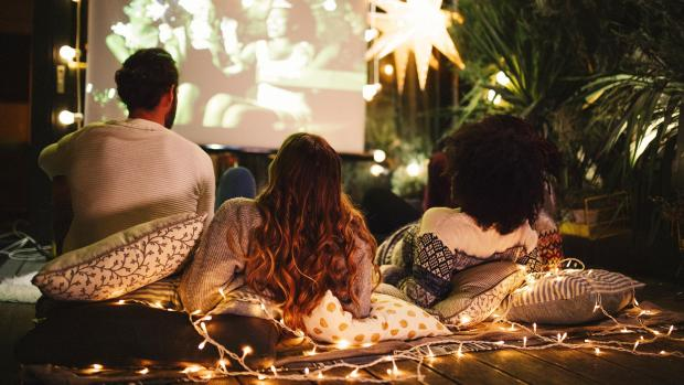 Borehamwood Times: Sit back and relax with a projector and outdoor screen. Credit: Getty Images / M_A_Y_A