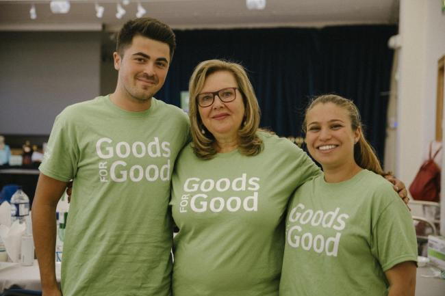 Rosalind Bluestone, centre, is the founder of Goods for Good. She is pictured at a fundraising quiz pre-Covid-19.