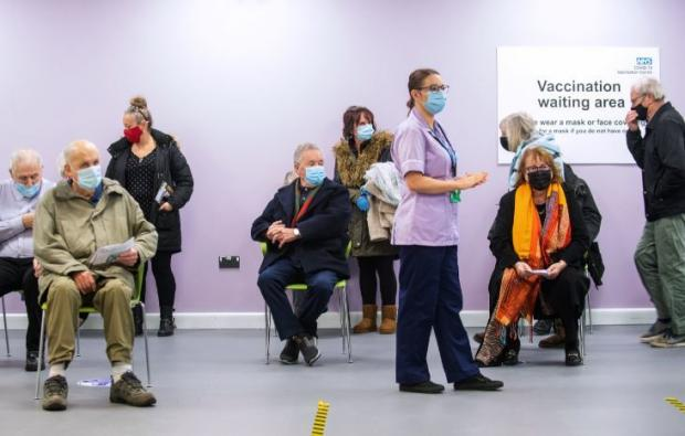 Borehamwood Times: A waiting area at the NHS vaccination centre in Stevenage. Credit: PA