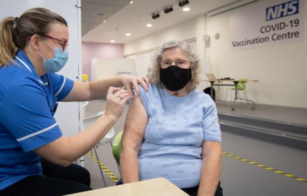 Borehamwood Times: Margaret Austin, 87, on her first time out of the house in six months, receives an injection of a Covid-19 vaccine. Credit: PA