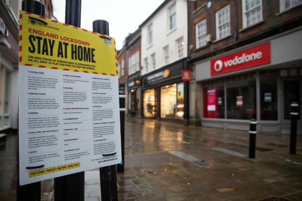 A 'Stay at home' coronavirus poster in an empty high street