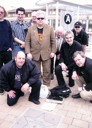 Fans of The Prisoner around the star of Patrick McGoohan at Elstree & Borehamwood Station