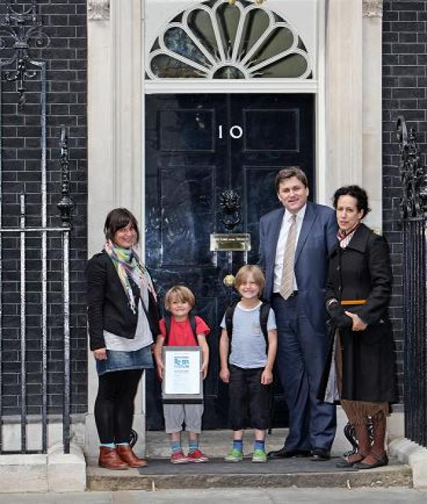 Borehamwood Times: Deputy Mayor for Policing Kit Malthouse hands the petition in at Downing Street with Claire Lambert and her children and Ms Reeves