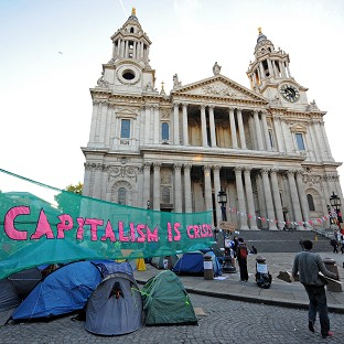 The removal of an anti-capitalist camp outside St Paul's Cathedral has begun