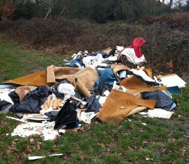 Construction waste fly-tipped on footpath