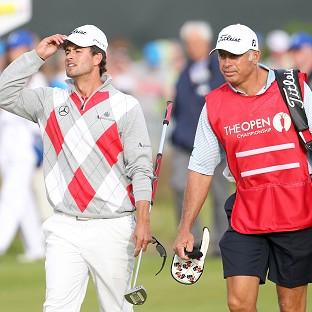 Adam Scott walks with his caddie Steve Williams during day three of the 2012 Open Championship
