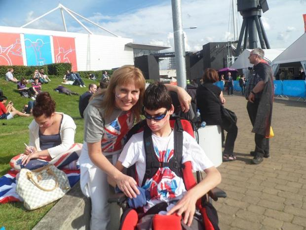 Josh made it to the Olympics in the end after his mum, pictured, and dad, stood up to the station staff