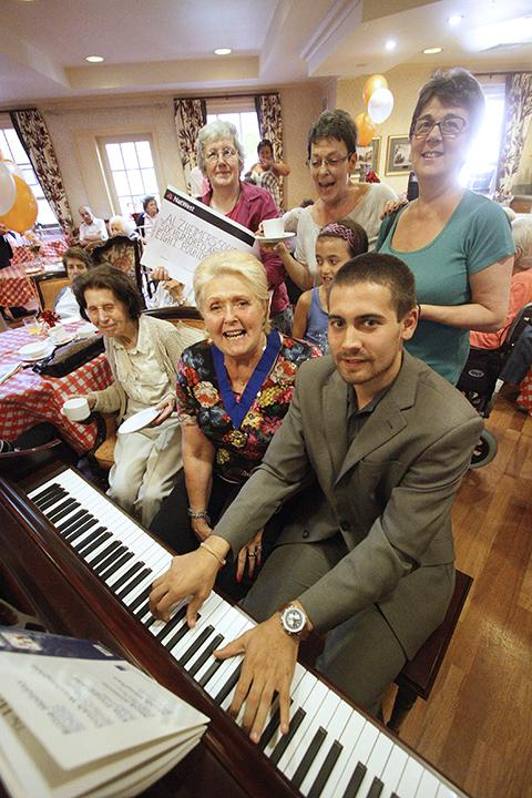 Pianist Adam Lancaster with Councillor Sandra Parnell and residents enjoying the tea party