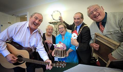 Brian Jackon on the guitar, president of WI Elsie Roberts, Gill Fowler, Cllr Charles Kelly, entertainer Nick Male