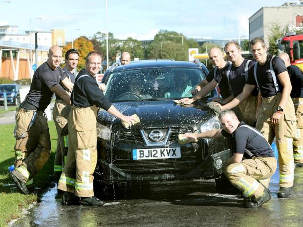 Borehamwood Times: Borehamwood firefighters at the last charity car wash