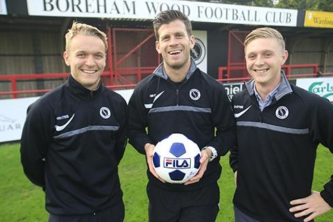 L-R: Midfielder Chez Isaac, assistant manager Luke Garrard and vice chairman Billy Hunter