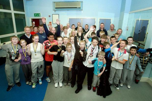 Kids winning medals at BoxCleva late last year