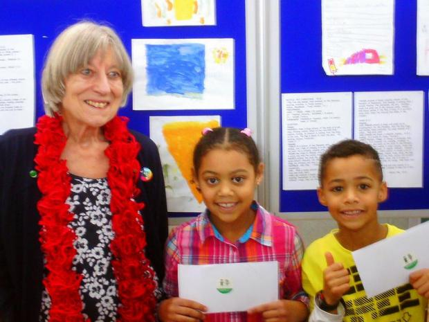 Borehamwood Times: Ann Goddard with the art competition winners. Photo: Pat O'Donnell
