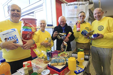 Rotarians help collect food at Tescos last week