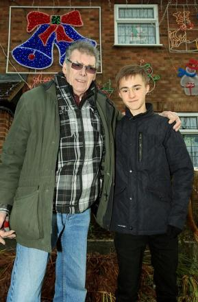 Mr Press with his grandson, Ross, who helped erect the lights