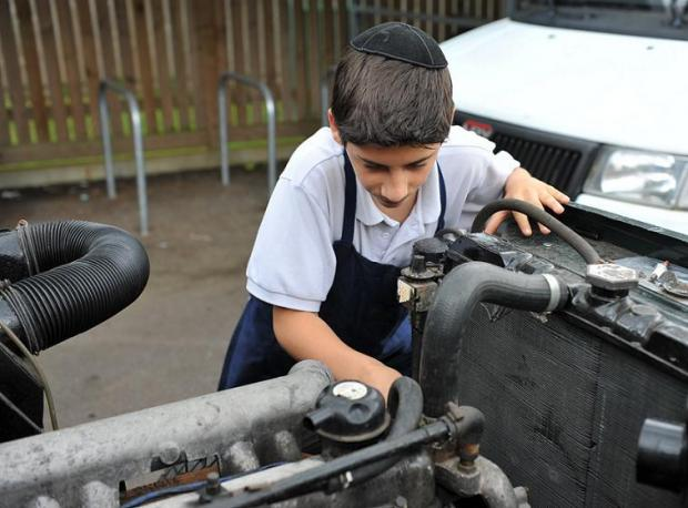 A son working on the land rover