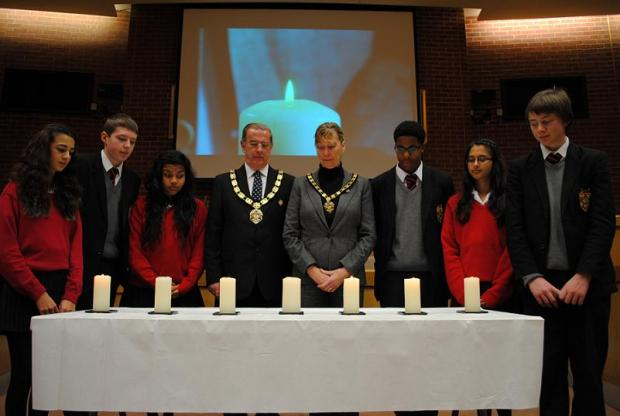 Students paying their respects at a Holocaust memorial event last year