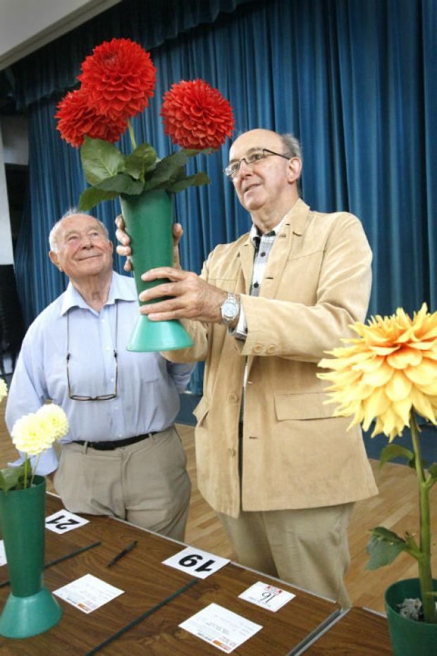 Dr Robin Boar judging flowers with Show Secretary Len Anderson at last year's event
