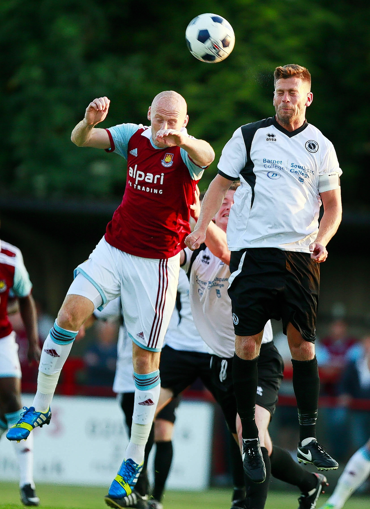 James Collins challenges for the ball with Boreham Wood's Luke Garrard