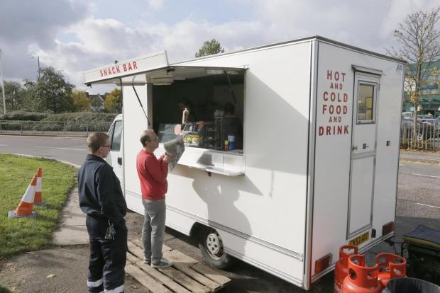 Borehamwood Times: Customers outside the burger van