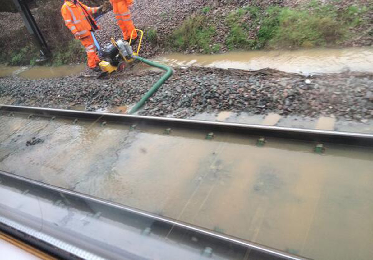 Workers are trying to clear the flooded tracks at Borehamwood & Elstree train station. Picture: First Capi