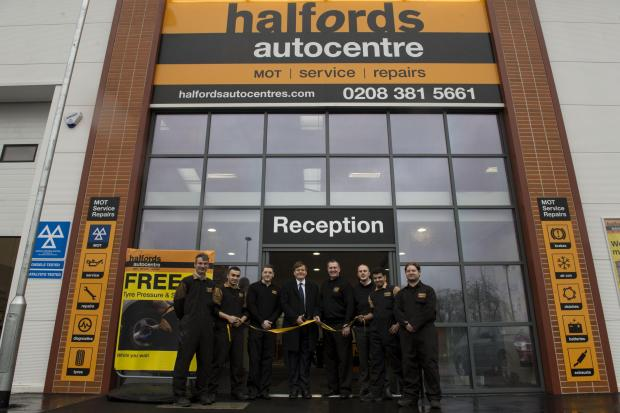 Borehamwood Times: James Clappison cuts the ribbon on Halfords in Borehamwood