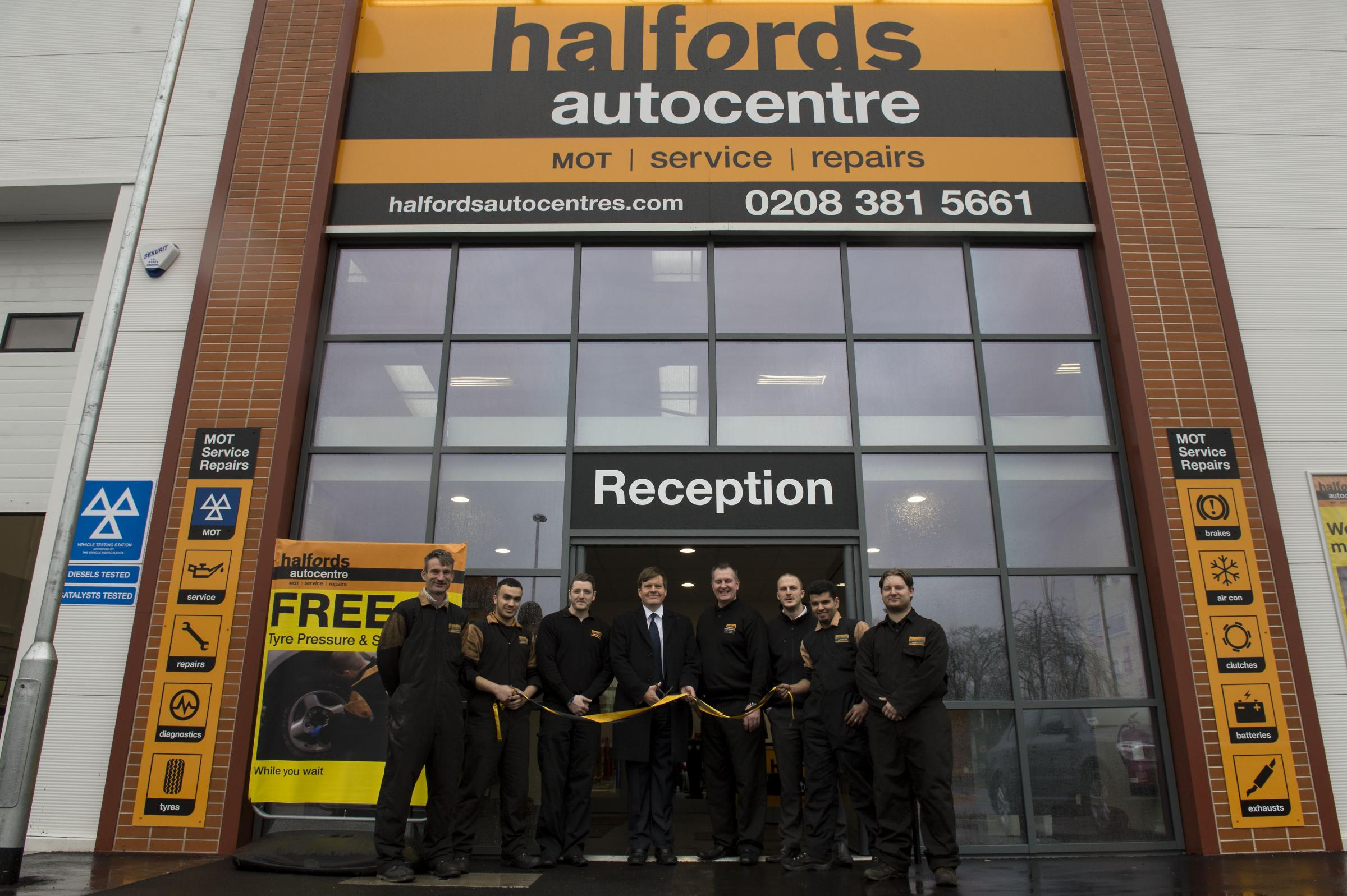 James Clappison cuts the ribbon on Halfords in Borehamwood