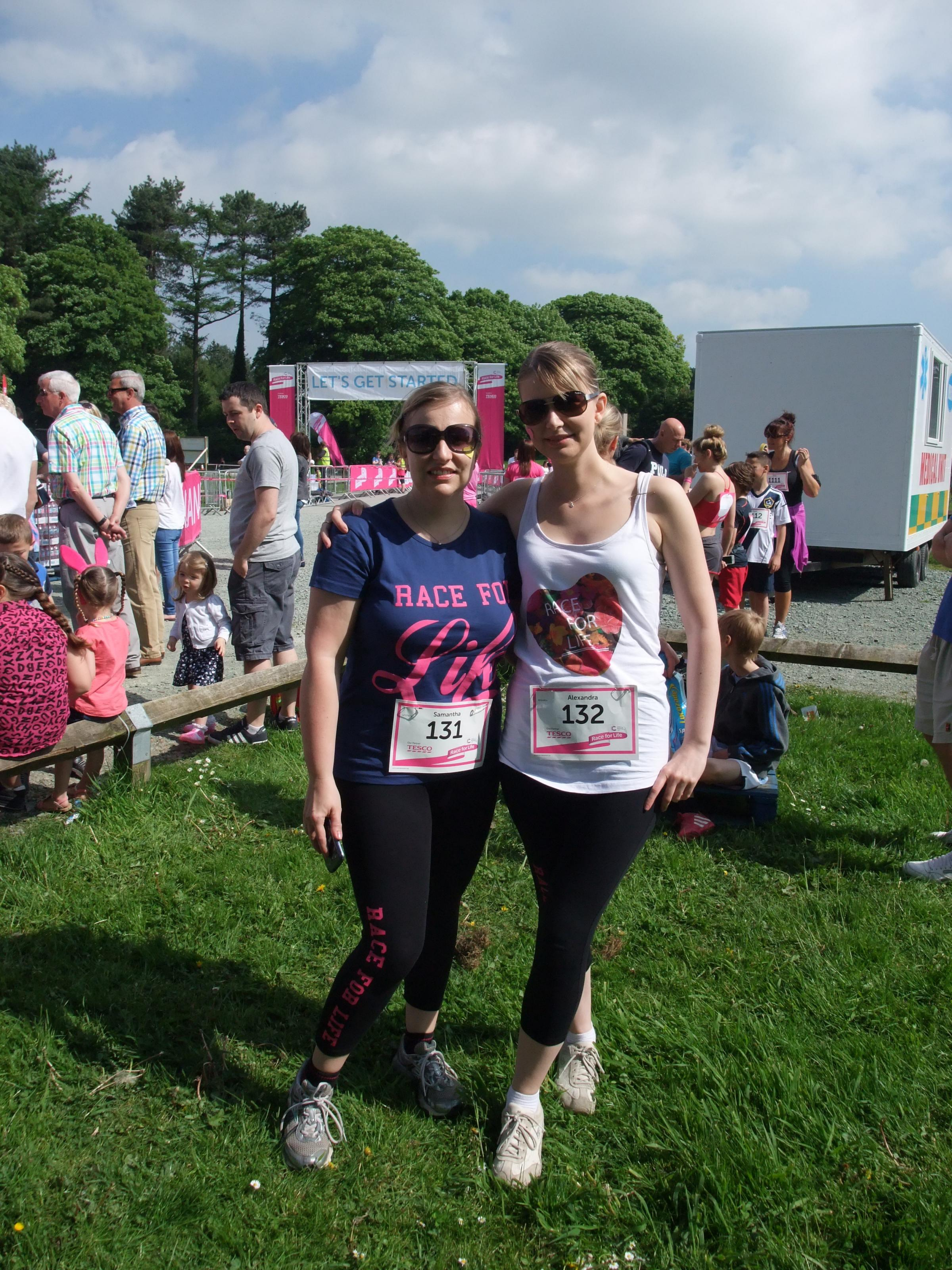 Alexandra Wood (right) and her sister Samantha have raised more than £1,000 for Cancer Research UK