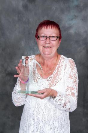 Superhero care worker unmasked at awards ceremony