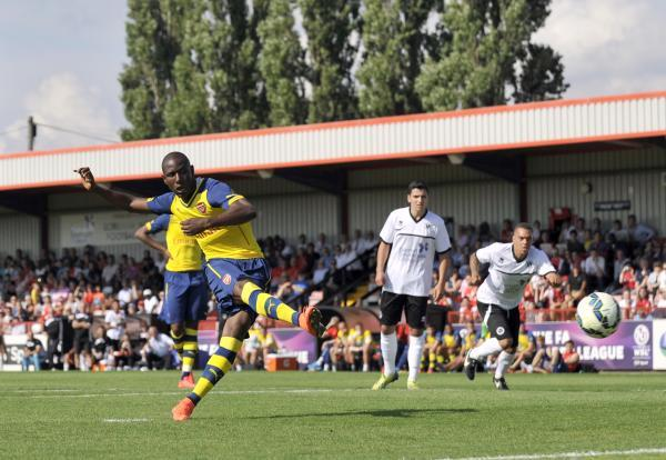 Benik Afobe sweeps home Arsenal's second from the penalty spot. Picture: Action Images