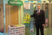 Specsavers in Borehamwood distributed 100 high visibility vests to children