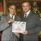 Borehamwood Times: George Clooney, left, swaps Hollywood for Highclere Castle on the set of Downton Abbey alongside co-star Hugh Bonneville