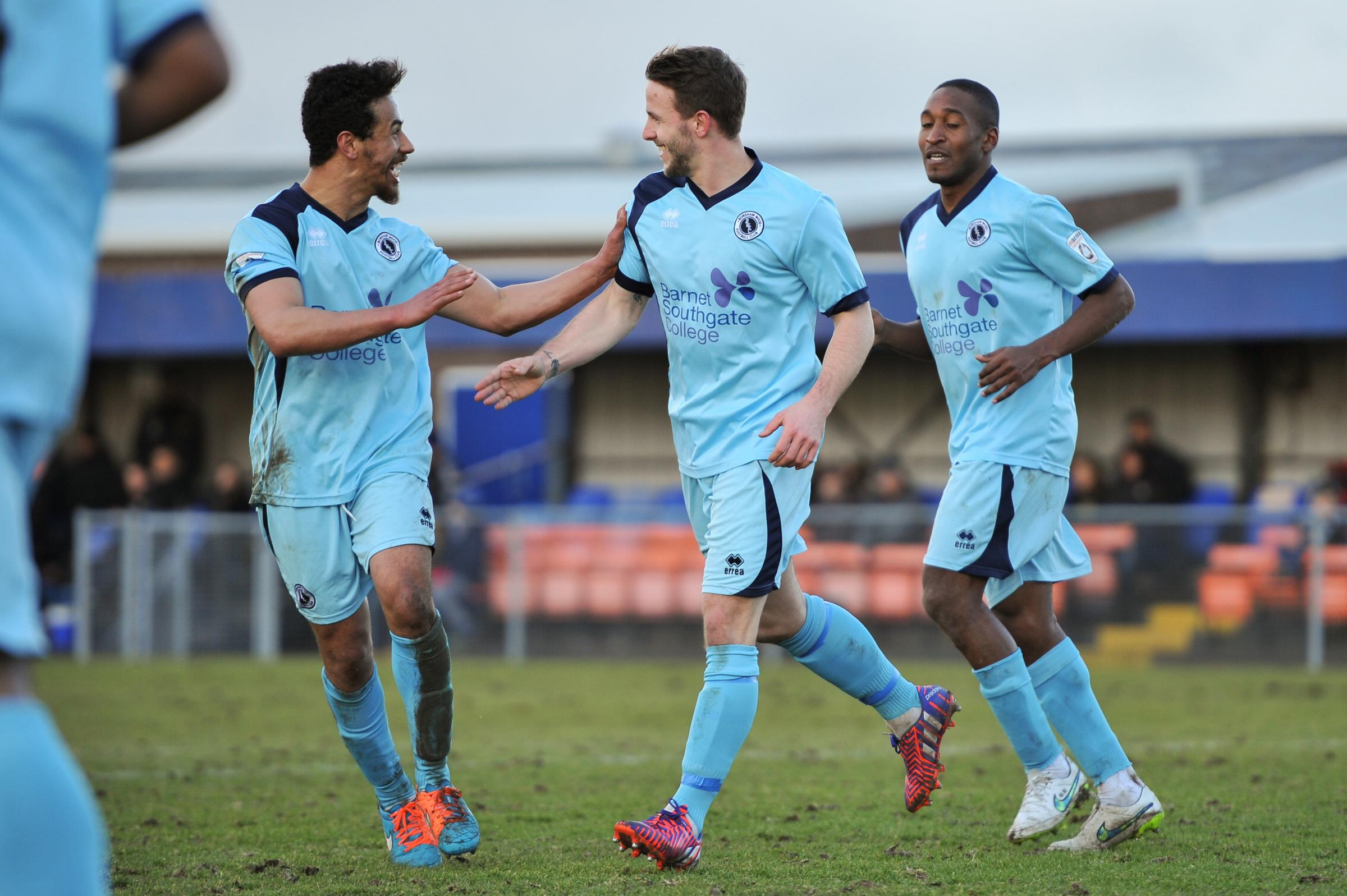 Charlie Walker (centre) celebrates his maiden strike for Boreham Wood. Picture: Sean Hinks