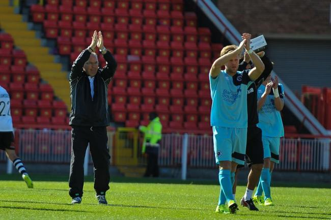 Ian Allinson and his players applaud the travelling Wood fans. Picture: SEAN HINKS