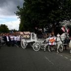 Borehamwood Times: A horse-drawn hearse carries the coffin of Paul Massey who was shot at his Salford home