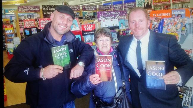 Jason Cook (right) at the book signing with fans of his books in WH Smith, Borehamwood