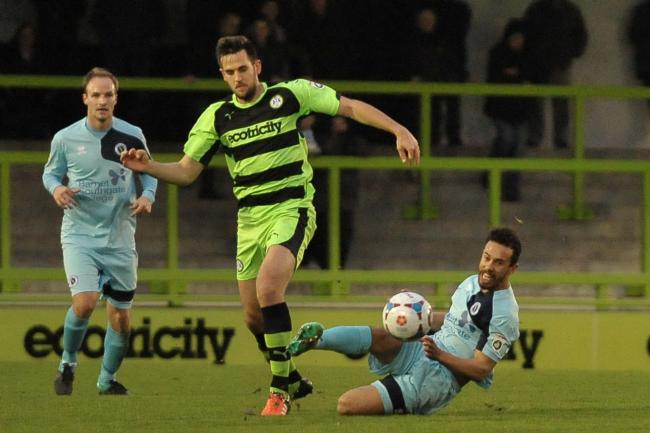 Sam Cox tries to win possession from Forest Green Rovers' Darren Carter. Picture: Sean Hinks