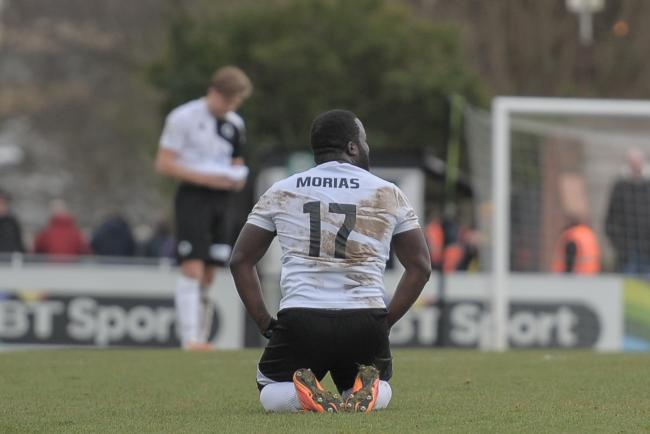 Down but not out: Junior Morias at the final whistle. Picture: Sean Hinks