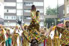 Performers were head over heels to be taking part in the Notting Hill Carnival in west London.