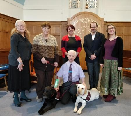 E J Cohen (ASL signer), Elizabeth Arendt (recipient of one of the dogs), Rabbi Celia Surget, Rabbi Paul Freedman, Esther Rose Bevan (BSL signer) with synagogue head warden Jack Alvarez in the front