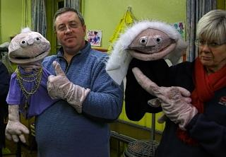Puppet power: Angus Henney and Helen Graham with two of Snow White's dwarves