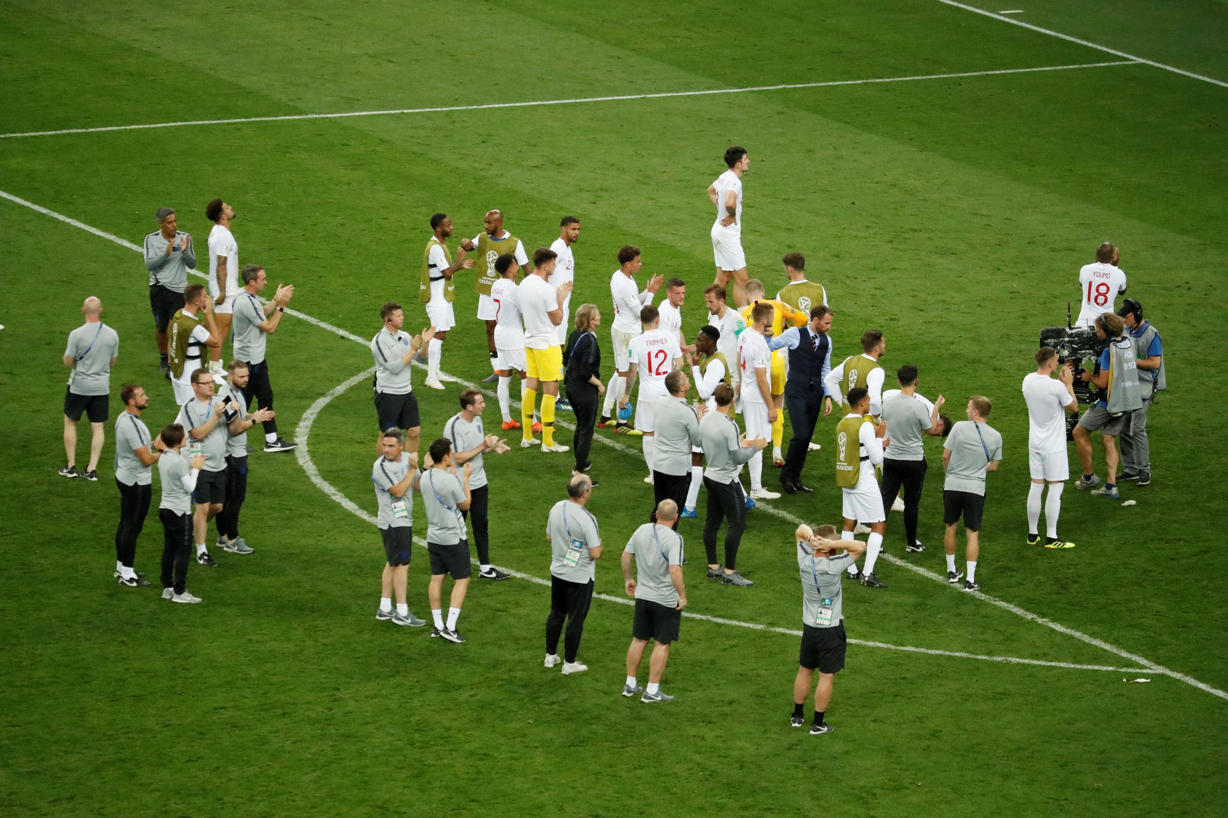 The England squad and staff applaud the fans after their defeat. Picture: Action Images